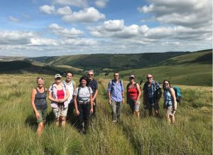 Birmingham walkers with Llanwrtyd guides on the path from Llyn Brianne reservoir to Llwyndern Farm near Abergwesyn.