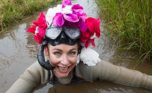 Woman bog snorkelling with flowers on her head in the championship in Llanwrtyd Wells, Wales