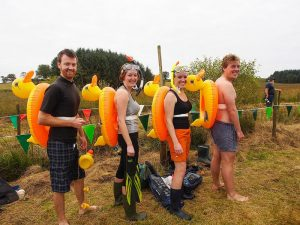 Bog snorkelling competitors in specialist gear.