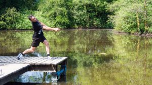 Scottish champion (Dougie Isaacs) establishing a new Guinness World Stone Skimming Record with a throw of 121.8 metres.