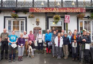 Hikers outside the Neuadd Arms in Llanwrtyd Wells