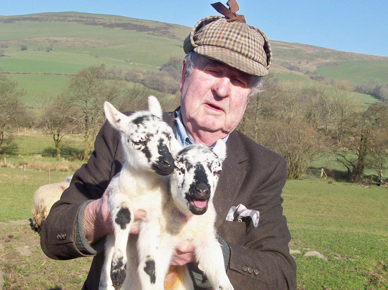 Idris Jones farmer with two of his lambs