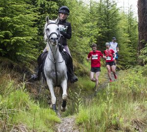 running, horse race, man v horse, forest, runners, wales