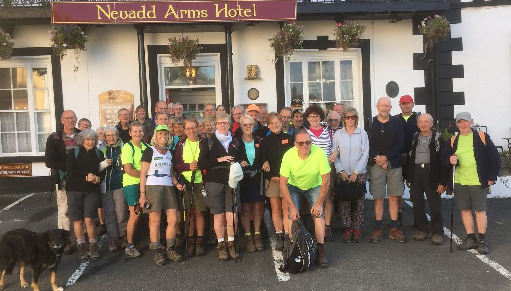 Group portrait of walkers outside the Neuadd Arms in Llanwrtyd Wells