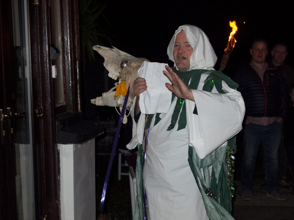 The Mari Lwyd sings a verse of song in Welsh.
