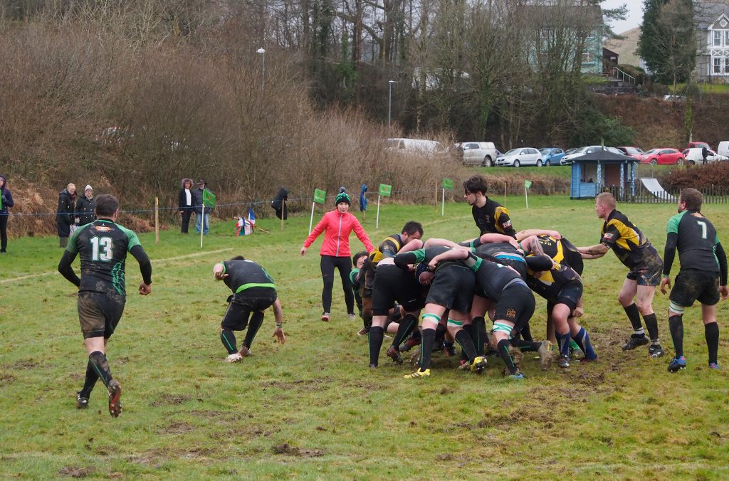 Action photograph of rugby match at Dolwen Field.